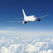 Airplane in the sky - Passenger Airliner — Stock Photo