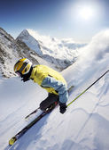Skier in high mountains — Stock Photo