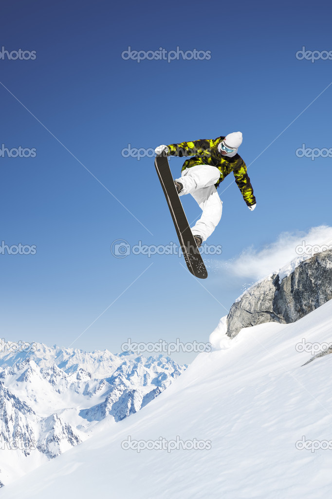 Jumping snowboarder in the high mountains — Stock Photo #3196590