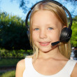 Stock Photo: Little girl with headphones