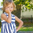 Beautiful little girl playing in the park — Stock Photo #2720615