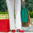 Female legs and shopping bags — Stock Photo