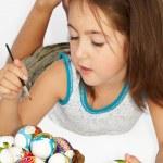 Girl painting easter egg — Stock Photo