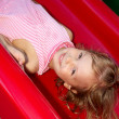 Little girl riding on a swing on the playground — Stock Photo #2722352