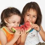 Girls eats watermelon — Stock Photo