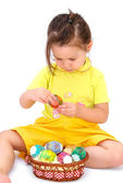 Little girl holding easter eggs — Stock Photo