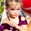 Beautiful little girl with painted face with paints — Stock Photo #2958429