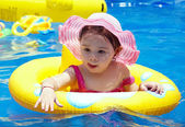 Small girl in the pool — Stock Photo