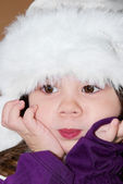 Girl in a fur hat — Stock Photo