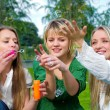 Girls inflating soap-bubbles — Stock Photo #3340836
