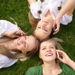 Girls talking on mobile phones — Stock Photo