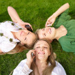 Girls talking on mobile in the park — Stock Photo
