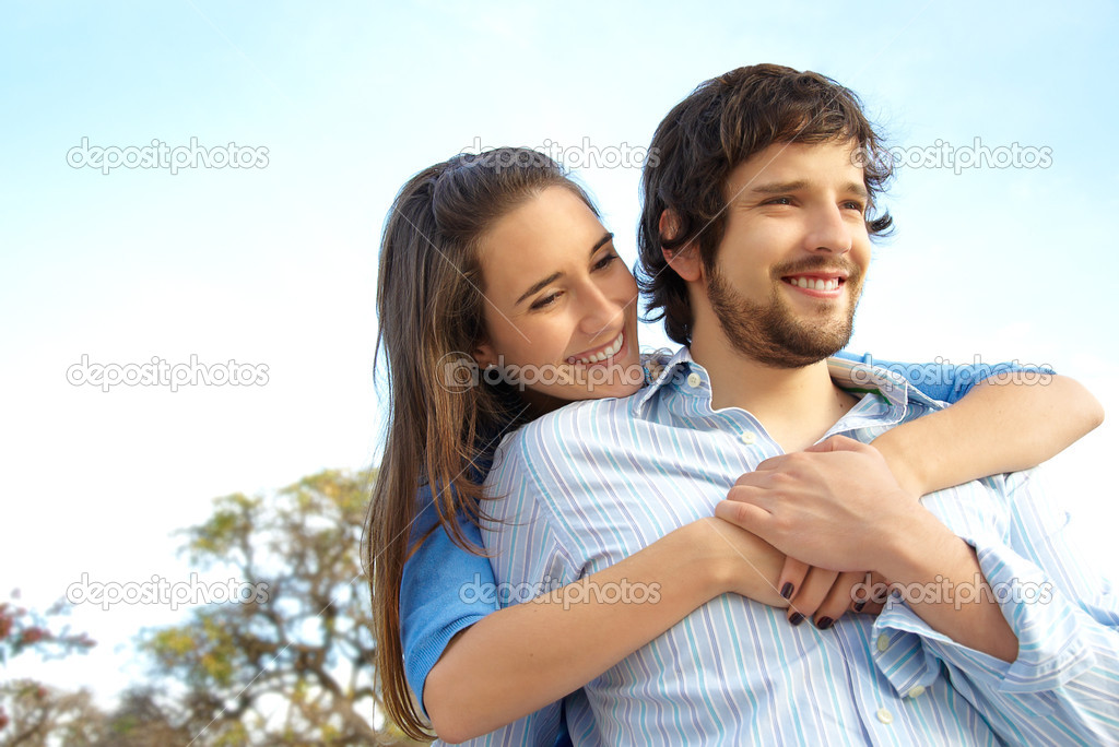 Happy loving couple playing in a park — Stock Photo #3571252