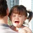 Stock Photo: Crying on father's shoulder