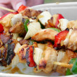 Shashlik in the hands — Stock Photo
