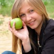 Woman with green apple - Stock Photo