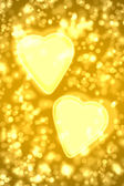 Two big gold hearts — Stock Photo
