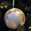 White ball on Christmas tree — Stock Photo