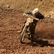 Enduro motocycle climbing slope — Stock Photo #3316370