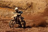 Enduro motocycle climbing a slope — Stock Photo