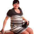 Pregnant woman  sitting on old suitcase — Stock Photo