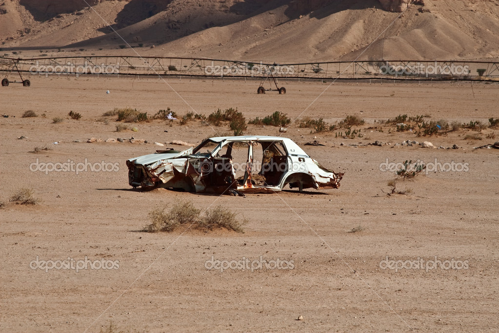 Abandoned car wreck in the desert  Stock Photo #3124581