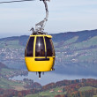 Cable car over alpine lake — Stock Photo #3160541