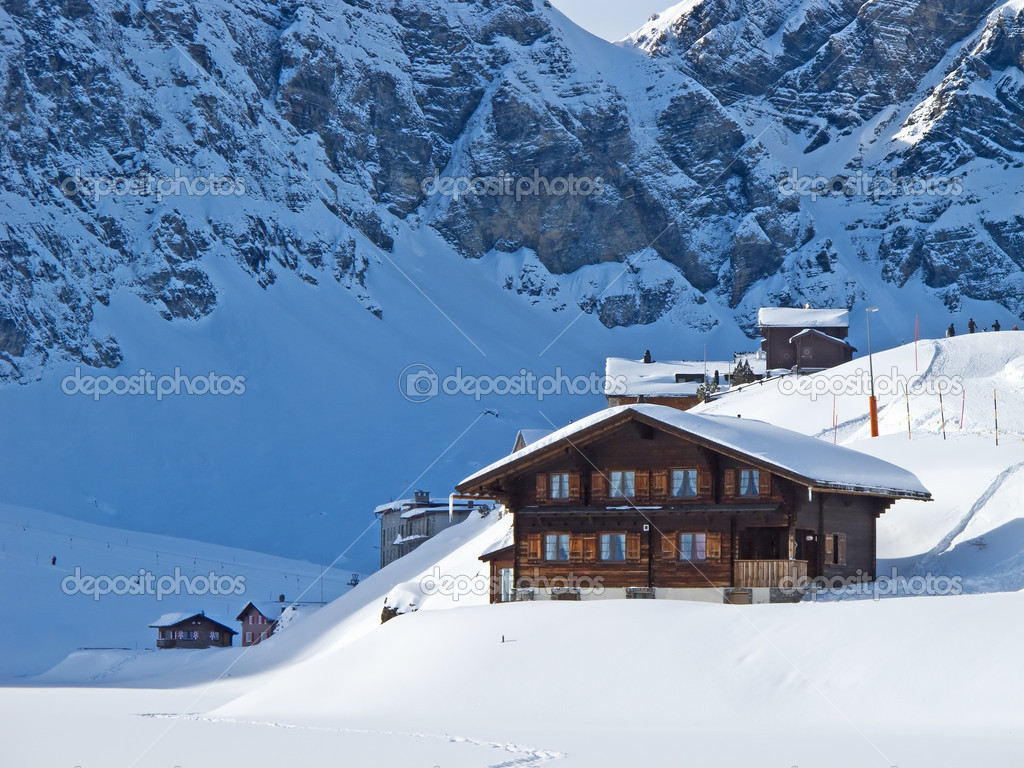 Winter holiday house in swiss alps — Stock Photo #3370051