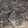 Ancient Assyrian wall carvings - Stock Photo