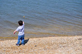 Boy Skipping Stone on Left — Stock Photo