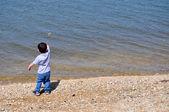 Boy Skipping Stone on Left — Stock Photo