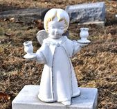 Gravesite - Angel - blonde with candle holders — Stock Photo