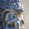 Gravesite - Angel on tombstone close up - Stock Photo
