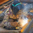 Stock Photo: Welder welding metal