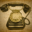 Old vintage black phone with disc dials — Stock Photo #3045879