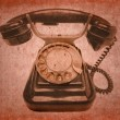 Old vintage black phone with disc dials — Stock Photo
