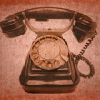 Stock Photo: Old vintage black phone with disc dials