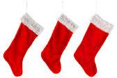 Three traditional red Christmas Stocking — Stock Photo