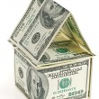 Dollar - the house. An abstract design from dollars in the form of dwelling — Stock Photo