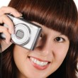 The girl with the photocamera on a white background — Stock Photo