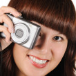 The girl with the photocamera on a white background — Stock Photo #3311430
