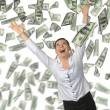 The woman and is a lot of money falling from above — Foto Stock