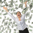 The woman and is a lot of money falling from above — Stockfoto