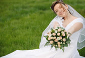 The bride on a lawn — Stock Photo
