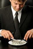 El empresario tener dólares cena — Foto de Stock