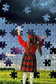 The girl assemble big puzzle — Stock Photo