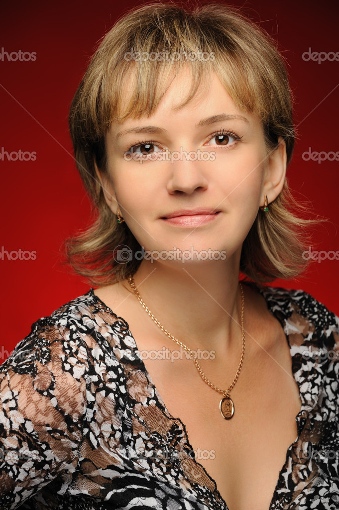 Portrait of the young girl on a red background. The European appearance — Stock Photo #3311311
