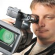 The man with a videocamera - Stock Photo