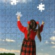 The girl assemble big puzzle — Stock Photo #3494464