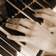 Hands above keys of the piano. Old color — Stock Photo